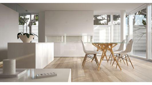 A madeira crua com o vidro deixam a sala de jantar clean