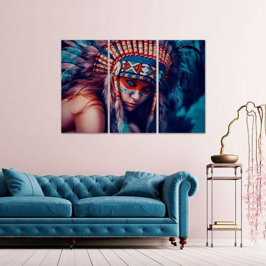 sala clean com sofa azul e quadro decorativo na mesma cor.