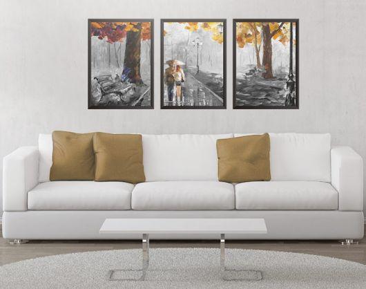 quadro decorativo paisagem em sala branca com sofa branco e almofadas marrons.