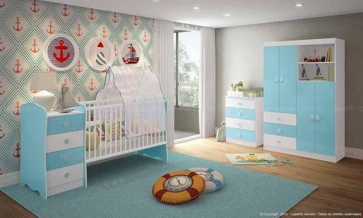 Ideia de tapete grande azul para quarto de bebê