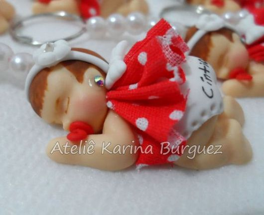Bebê de biscuit para menina com vestido vermelho