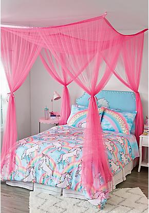Cama com dossel pink e decoração de unicórnio