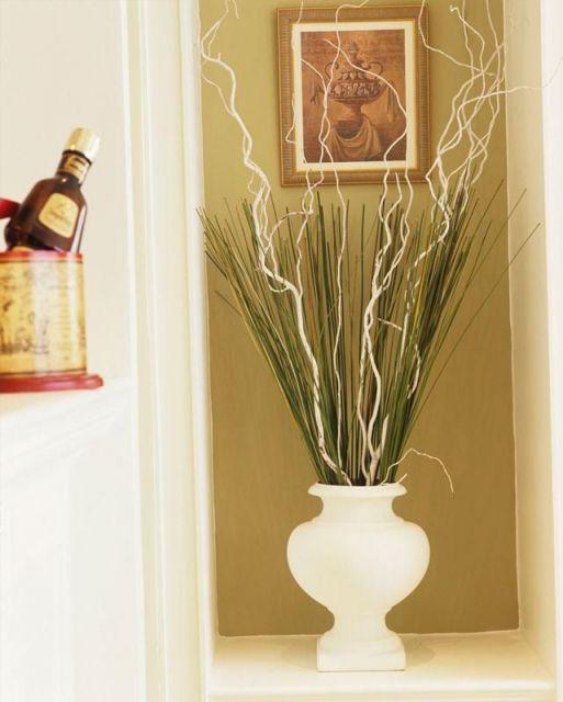 Sugestão de hall de entrada decorado com vaso branco