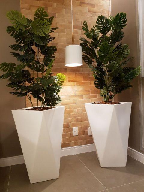 Arbustos combinam com vasos grandes
