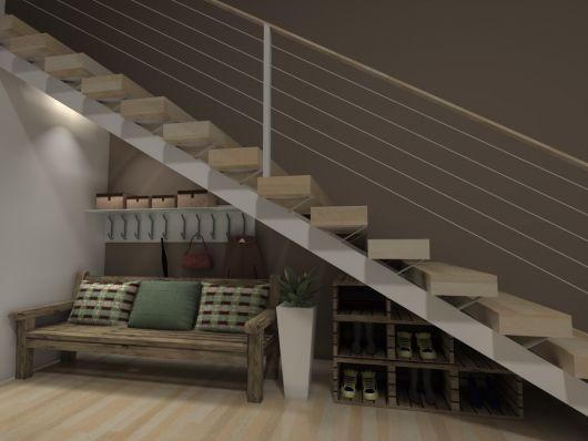 Ideia de área para descanso embaixo da escada com sofá