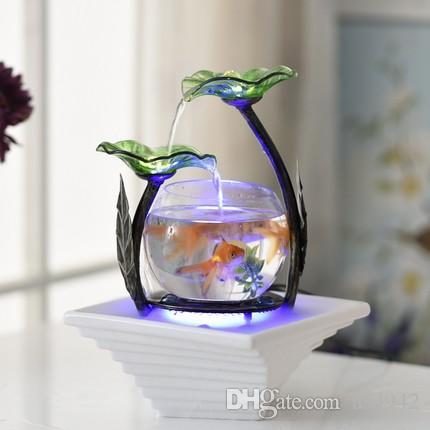 fonte de água decorativa de flores nas cores verde, azul e branco.