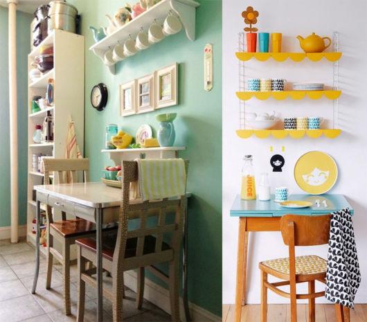 Cozinha branca com verde e prateleiras coloridas.
