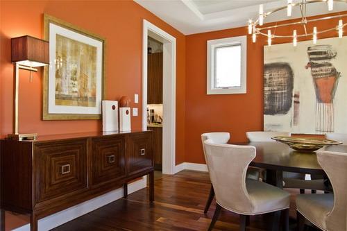 Outra opção de sala de jantar com cores quentes