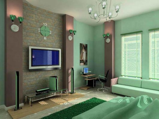 Sala de TV diferente com tom de verde claro
