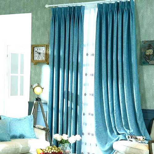 Que tal então uma cortina turquesa para compor sua sala?