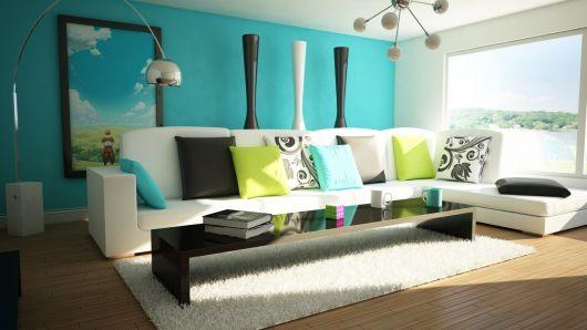 A parede azul destaca a decoração e o verde fica ótimo nos acessórios decorativos