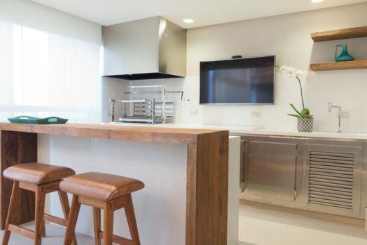Proposta minimalista para uma área gourmet de apartamento