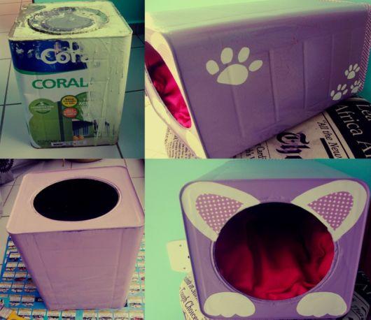Uma pequena casinha para um cão de pequeno porte feita com lata de tinta