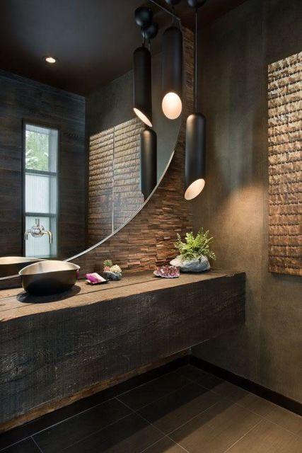 Bancada grande em meio à parede com cimento queimado e detalhes em tijolos: uma perfeita inspiração rústica