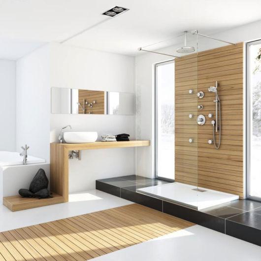 A bancada de madeira para banheiro em S combinando com outros detalhes do mesmo material