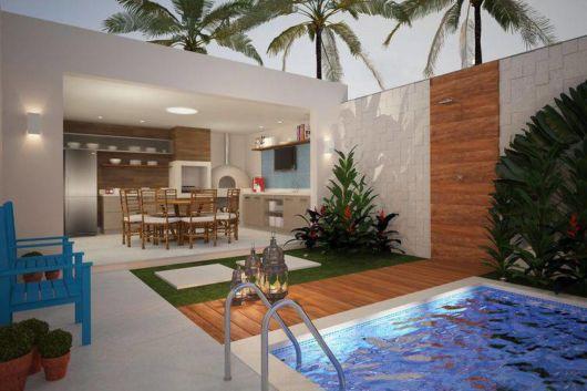 Decoração moderna de varanda gourmet e piscina