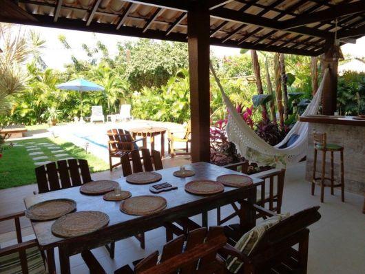 Panorama de decoração rústica para área gourmet com piscina