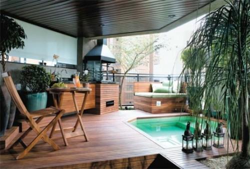 varanda gourmet com piso amadeirado combina com a decoração rústica