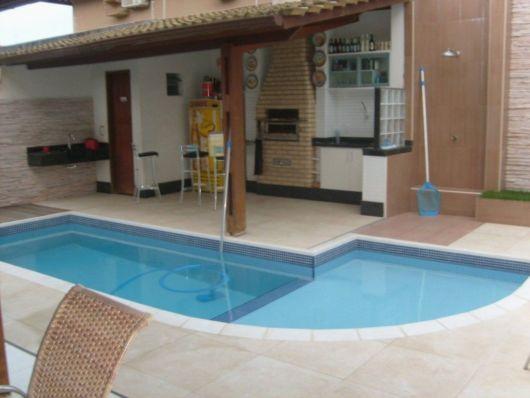 Projeto de área gourmet com churrasqueira e piscina pequena
