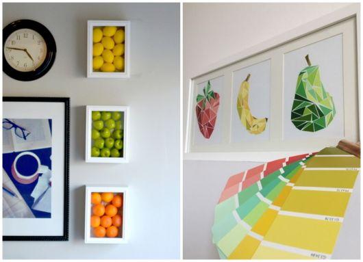 quadros de frutas nas cores laranja, amarelo e verde.
