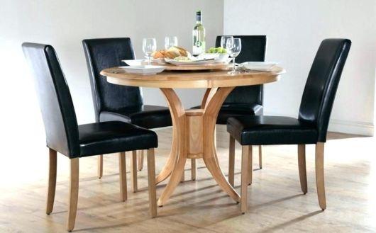 mesa de jantar retrô com estofado preto