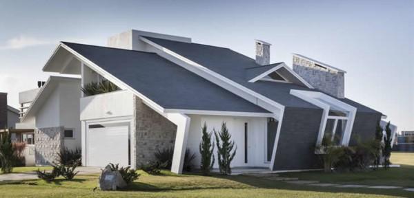 Casa contemporânea com telhado diferente cinza