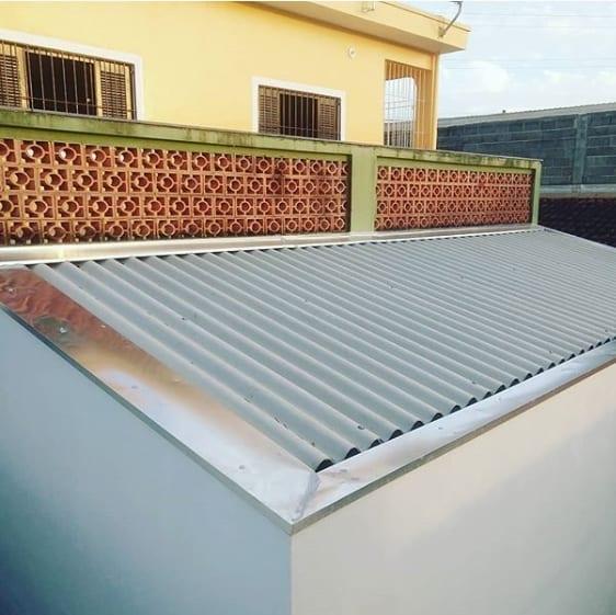 pingadeira de zinco no telhado