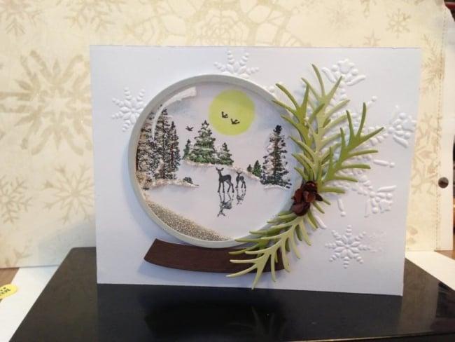 cartão de natal com globo de neve