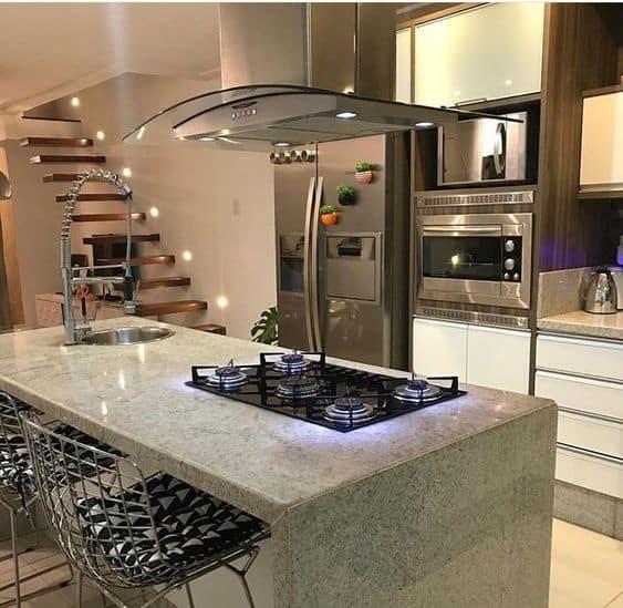 ilha de granito com cooktop