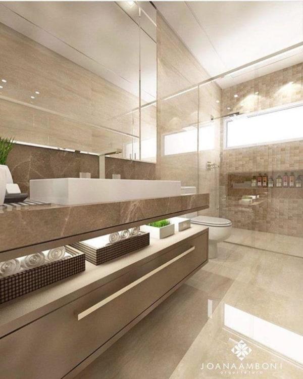 Decoração sofisticada usando tons perolados em banheiro