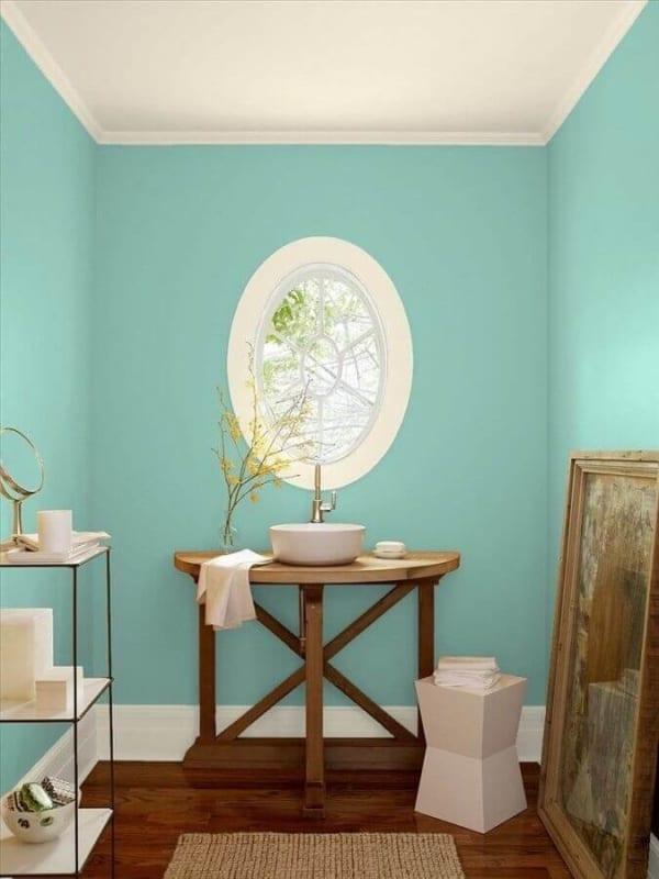 lavabo decorado com parede verde água 46
