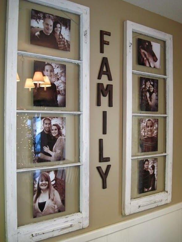 Parede decorada com fotos de família