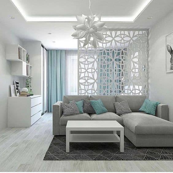 sala de estar verde claro com sofá cinza 06