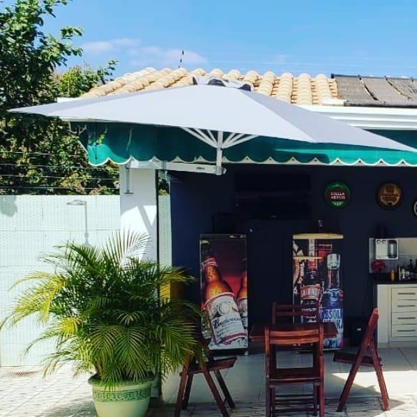 área gourmet com ombrelone de parede