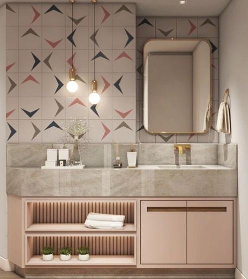 Banheiro feminino com pia de mármore