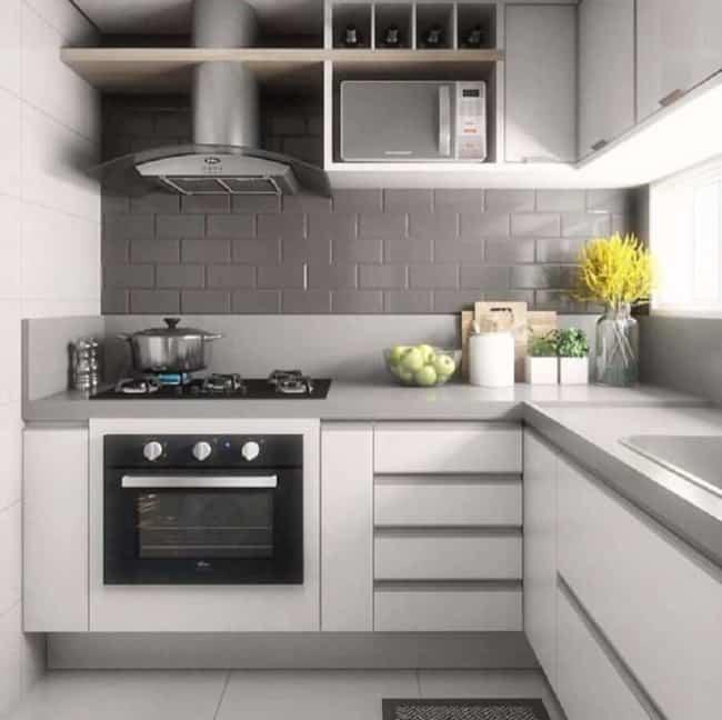 Cozinha com tijolinhos cerâmicos cinza