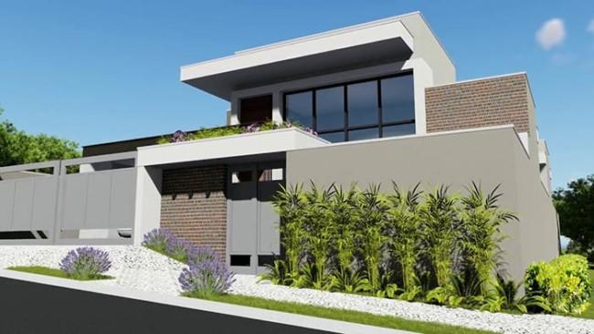 Entrada de casa moderna com jardim externo