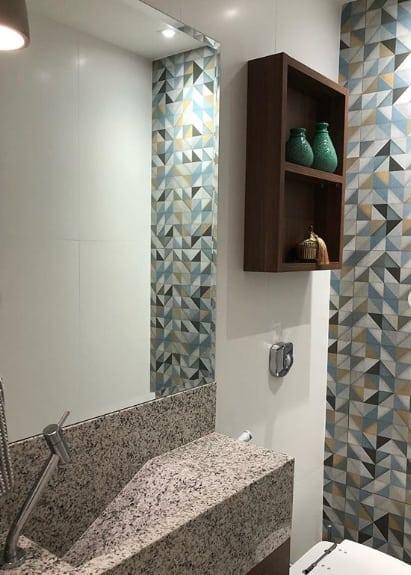 lavabo pequeno com pia esculpida em granito