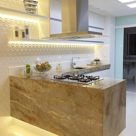 bancada de mármore bege com cooktop