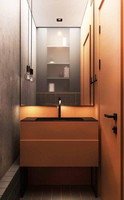 Laranja clarinho em lavabo moderno
