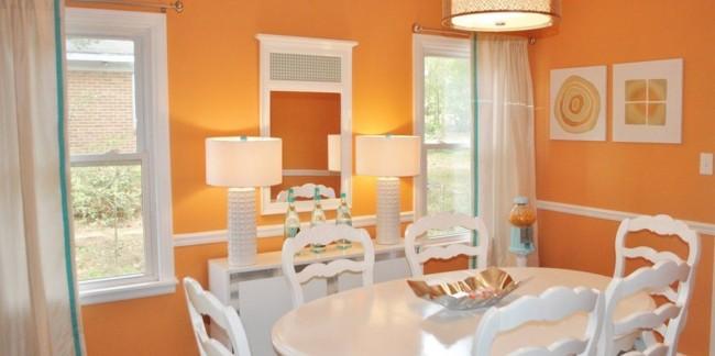 Parede laranja na sala de jantar