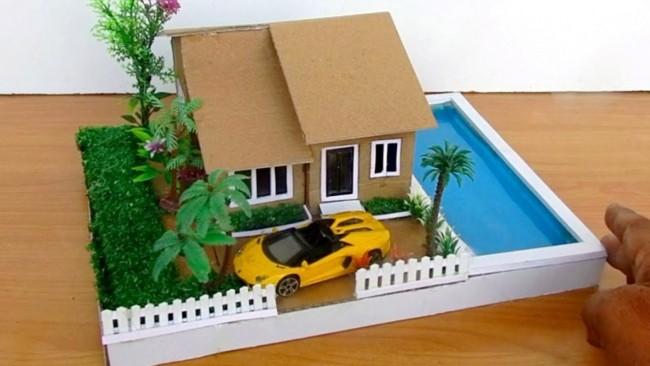 maquete de papelão de casa com piscina