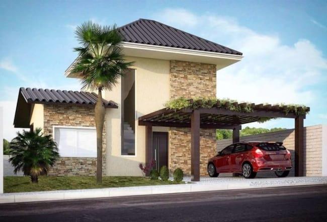 Casa moderna com fachada em pedra mineira