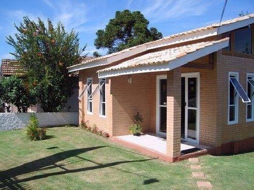 Casa pequena com tijolos a vista