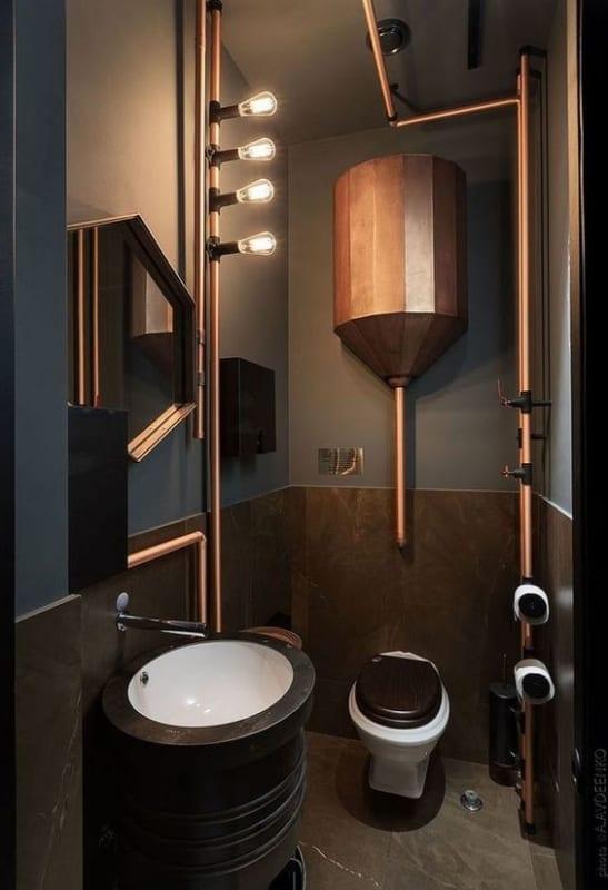 Tubulação aparente no banheiro moderno