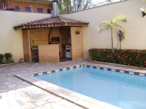 Varanda gourmet coberta com piscina