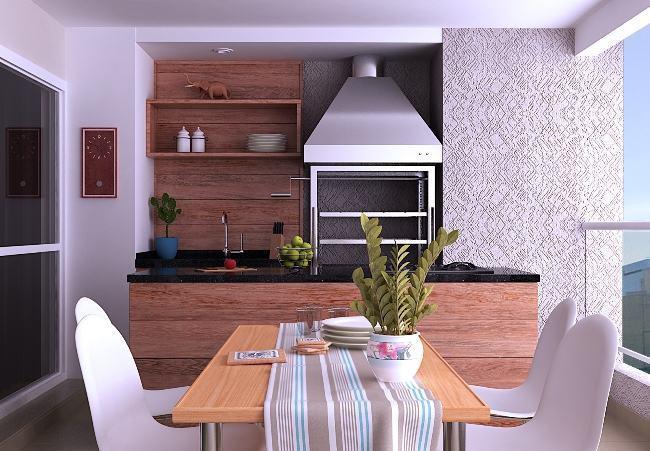 Varanda gourmet de apartamento com churrasqueira de inox