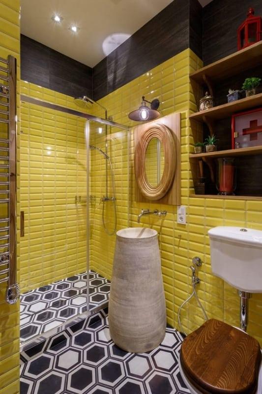 banheiro decorado em amarelo e preto