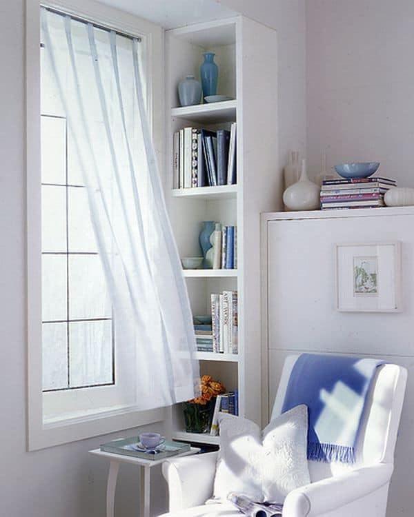 Cantinho da leitura na sala com estante planejada branca13