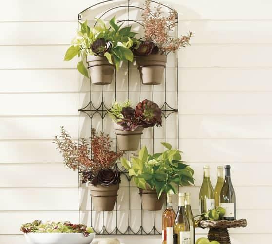 Floreira de ferro para parede com folhagens16